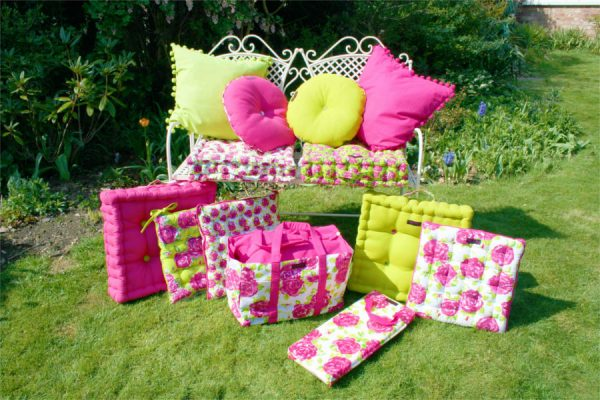 garden seat bench with pink and lime cushions