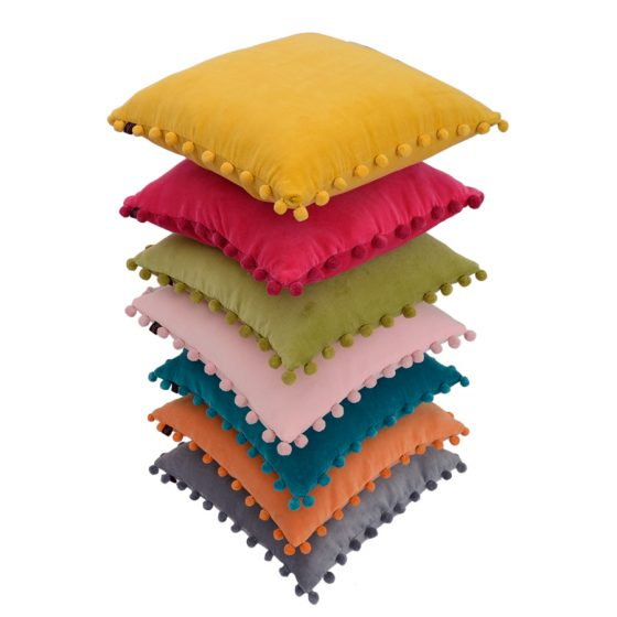 pile of velvet pompom cushion