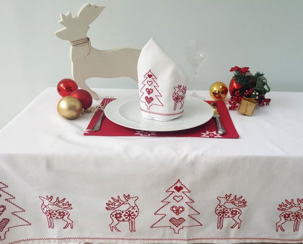 red Christmas placemats on white table cloth